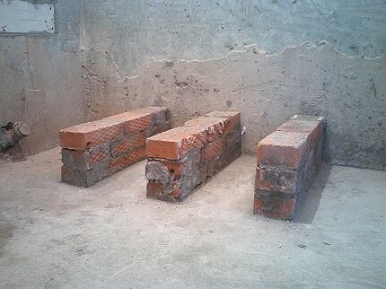 How many brick supports do you need for a bath?