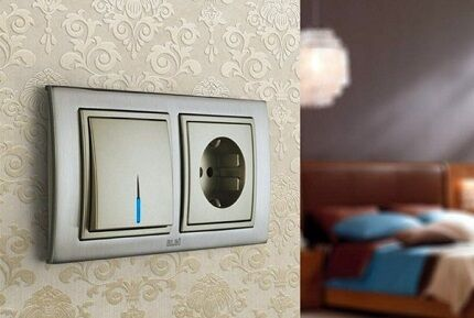 Socket and switch in one housing