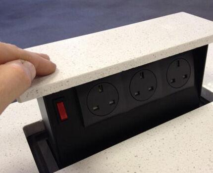 Retractable socket in stone worktop
