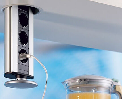 Retractable outlet in wall cabinet