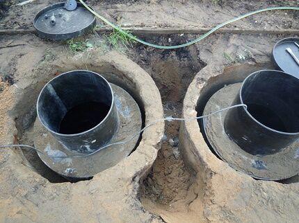 Конструкция выгребной ямы с переливом