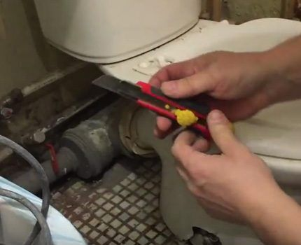 The knife will help remove the flexible drain.