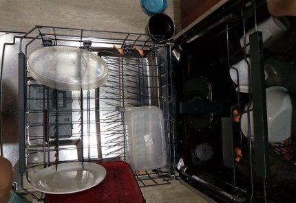 Нижнее отделение посудомойки