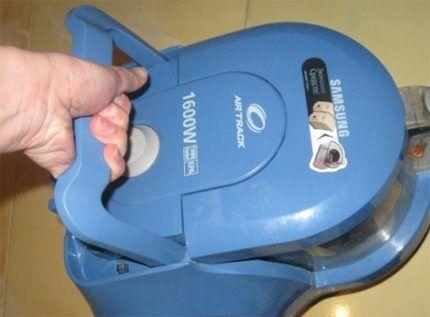Vacuum cleaner function handle
