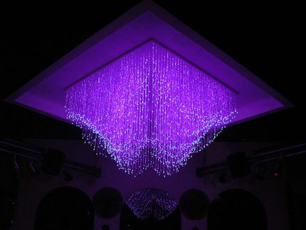 Ceiling decoration with fiber optic threads