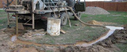 Отвод воды при промывке скважины
