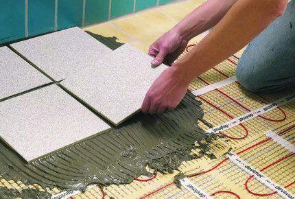 Укладка плитки на греющие полы