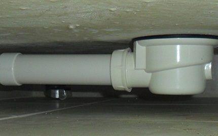 Сифон под низкобортовым поддоном