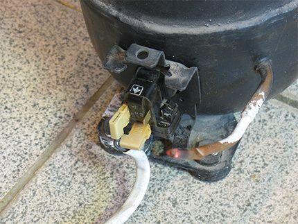 Установленное на компрессор реле