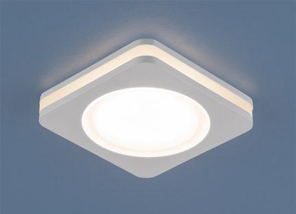 Вид точечного светильника после установки в полотне