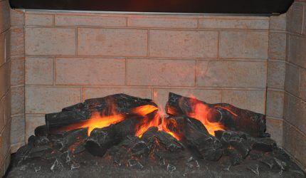 Сжигание полена для прочистки дымоходов