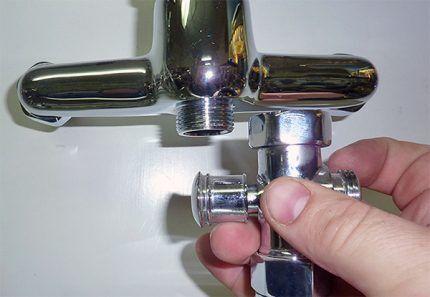 Переключатели у смесителей для ванн