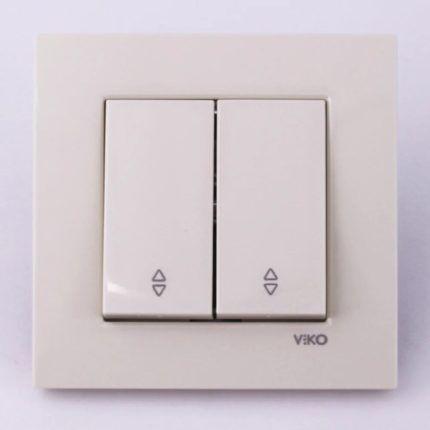 Двухклавишный проходной выключатель